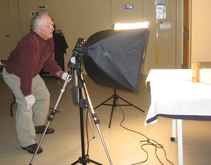 Fred Speth 1 photographing artifacts